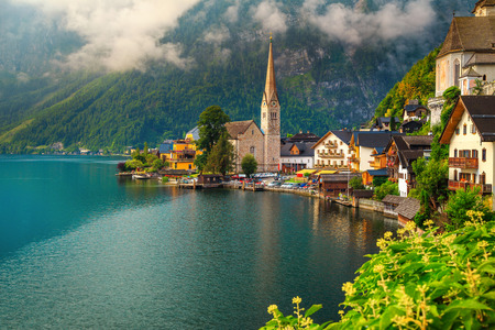 Fabulous alpine village with majestic lake on cloudy day, Hallstatt, Salzkammergut, Austria, Europe