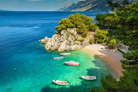 Amazing summer landscape with Adriatic Sea, Biokovo mountains and majestic bay, Brela beach, Makarska riviera, Dalmatia, Croatia, Europe