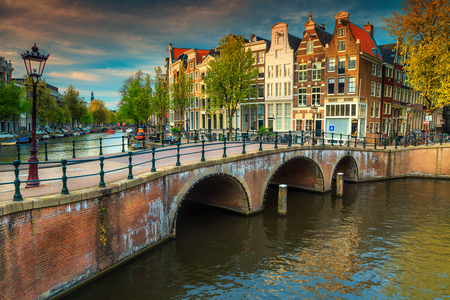 Wonderful spring cityscape, Amsterdam water canals and typical dutch houses on spectacular sunset, Netherlands, Europe Stock Photo