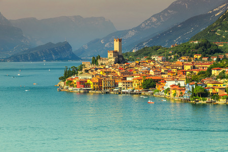 Fabulous Garda lake with high mountains in background and wonderful Malcesine mediterranean tourist resort, Italy, Europe