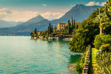 Spectacular luxury villa Monastero, amazing botanical garden decorated with mediterranean flowers, lake Como, Varenna, Lombardy region, Italy, Europe Archivio Fotografico