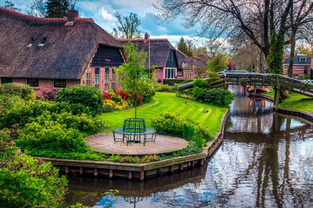 Famous romantical travel destination. The best visited touristic European village with traditional dutch houses and ornamental gardens, Giethoorn, Netherlands, Europe Stok Fotoğraf