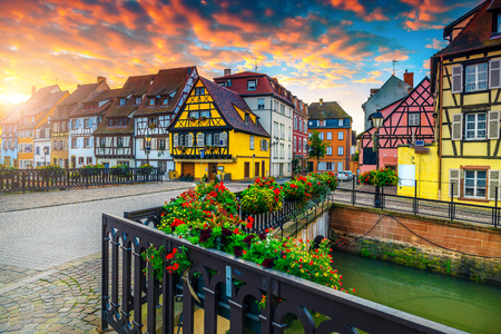 Famous excursion place and travel destination. Wonderful street view with colorful buildings and flowers, Colmar, France, Europe