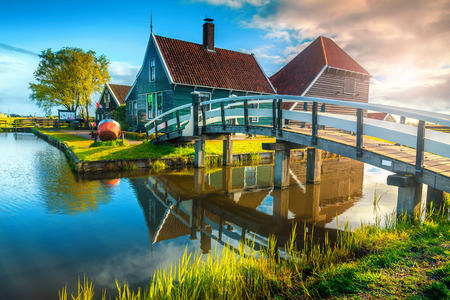 Beautiful travel destination, spectacular touristic village with wooden bridge and water canal, Zaanse Schans, Netherlands, Europe