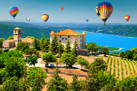 Fabulous Aiguines castle and spectacular vineyard. Amazing turquoise St Croix lake with colorful hot air balloons, near Verdon gorge, Provence, France, Europe 写真素材