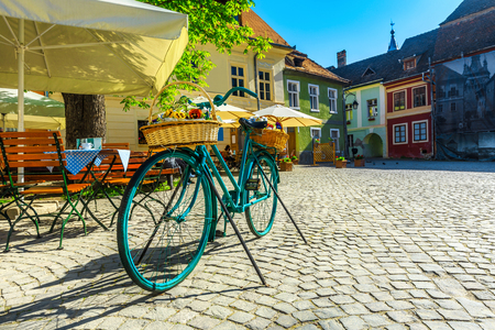 Fantastic travel destination, recreation and resting place with street cafe bar. Traditional colorful buildings and spectacular promenade, Sighisoara, Transylvania, Romania, Europe