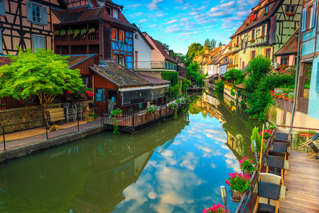 Gorgeous colorful traditional french houses on the side of river Lauch in Petite Venise, Colmar, France, Europe