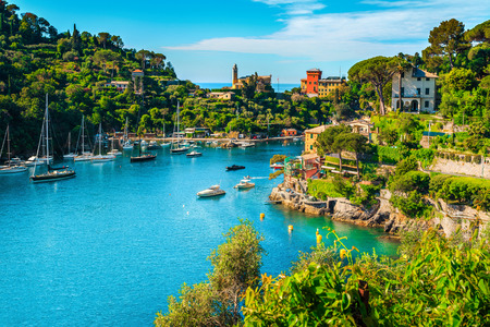 Wonderful bay with colorful mediterranean buildings and boats, yachts in spectacular vacation resort, Portofino, Liguria, Italy, Europe Фото со стока