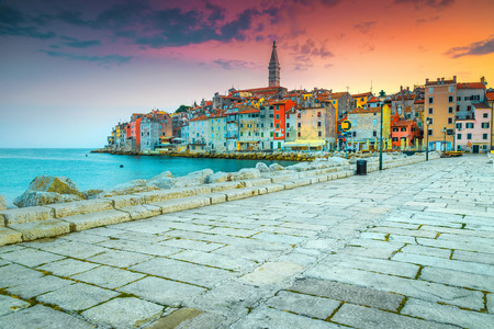 Popular vacation place, colorful old mediterranean buildings and seashore with spectacular promenade at sunset, Rovinj, Istria region, Croatia, Europe