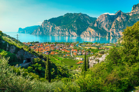 Picturesque place with lake and mountains, lake Garda with Torbole town, Italy, Europe
