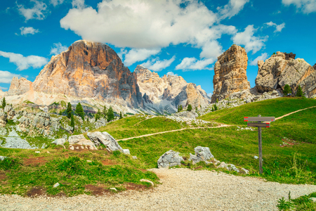 Picturesque landscape with amazing mountains. Wooden hiking signs, and direction signboards in the mountains, Dolomites, Italy, Europe