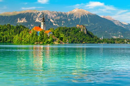 Wonderful travel and touristic place. Famous and spectacular lake Bled with picturesque Pilgrimage church on small island, Bled, Slovenia, Europe Imagens