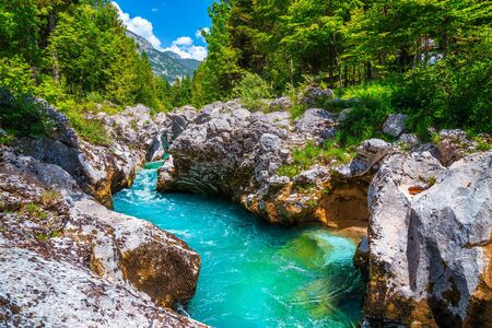 Popular rafting and kayaking place in Europe. Well known recreation place and kayaking destination. Amazing turquoise Soca river and gorge, Bovec, Slovenia, Europe
