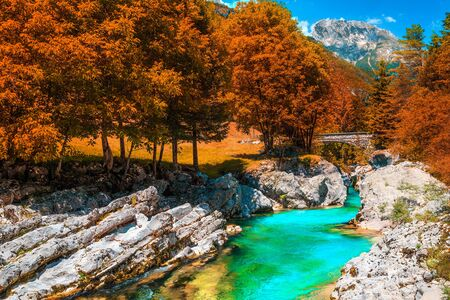 Famous rafting and kayaking location in Europe. Well known recreation place and kayaking destination. Autumn landscape with beautiful emerald color Soca river and gorge, Bovec, Slovenia, Europe Imagens