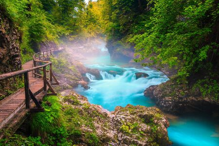 Fantastic and well known touristic attraction near Bled. Wonderful Vintgar gorge with wooden footbridge and emerald color Radovna river, near Bled, Gorje, Slovenia, Europe Imagens