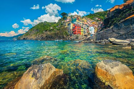 Beautiful travel and excursion place, picturesque mediterranean fishing village with harbor and colorful buildings, Riomaggiore, Cinque Terre, Liguria, Italy, Europe