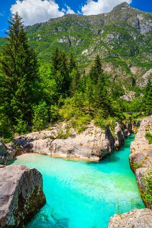 Beautiful rafting and kayaking place in Europe. Well known recreation place and kayaking destination. Spectacular turquoise Soca river and narrow gorge, Bovec, Slovenia, Europe Imagens - 129684045