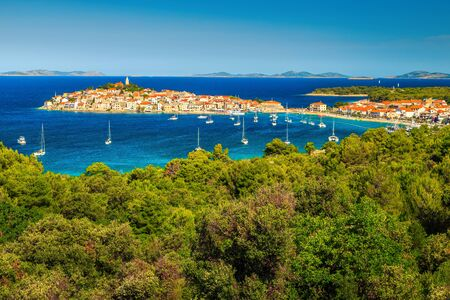 Popular travel and vacation destination. Famous tourisric resort with historic town on the peninsula. Picturesque bay with sailing boats and yachts, Primosten, Dalmatia, Croatia, Europe