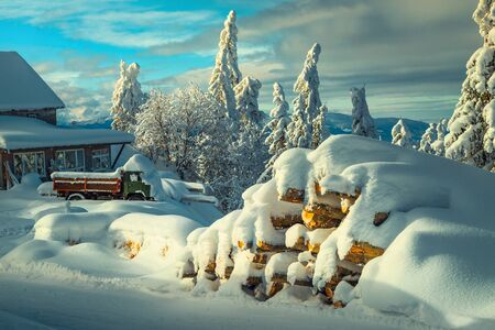 Winter and Christmas landscape with snow covered scenery. Winter rural landscape with snow covered old car and wooden mountain hut. Christmas and Happy New Year celebration concept Reklamní fotografie