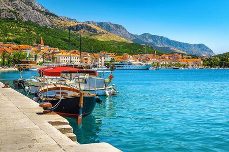 Amazing touristic and travel location. Adriatic resort with picturesque harbor and touristic boats, Makarska riviera, Dalmatia, Croatia, Europe