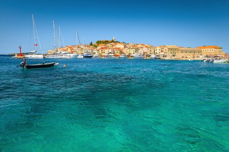 Well known Adriatic touristic destination. Admirable mediterranean old fishing village with stone houses and picturesque harbor, Primosten, Dalmatia, Croatia, Europe