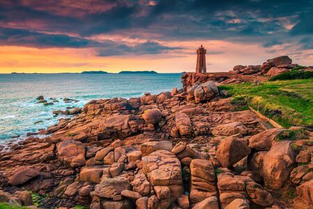 Picturesque place with pink granite rocks and spectacular lighthouse. Atlantic Ocean coastline with beautiful locations at sunset, Perros Guirec, Ploumanach, Brittany, France, Europe
