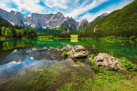 Magical mountain landscape and touristic place. Admirable superior Fusine lake and Mangart mountain in background, Julian Alps, Tarvisio, Udine region, Friuli Venezia Giulia, Italy, Europe