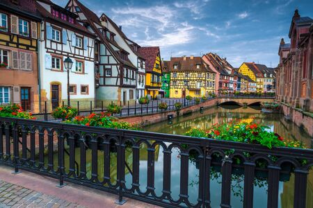 Colorful houses in row on the waterfront with flowery promenade, Colmar city center, Alsace region, France, Europe Banque d'images - 144042195