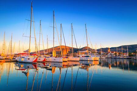 Trogir cityscape with sailing boats in the harbor at dawn. Beautiful travel and touristic destination, Dalmatia, Croatia, Europe