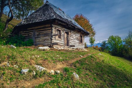 Old rural ramshackle wooden house on the slope, Bran, Transylvania, Romania, Europe