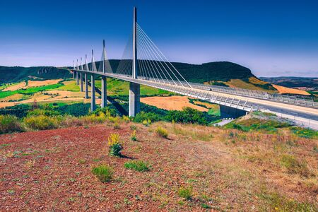 Famous building and landmark in France. Viaduct of Millau over the fields and valley, Aveyron region, France, Europe Banque d'images