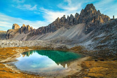 Majestic alpine landscape with turquoise mountain lake Lago dei Piani. Paterno mountain ridge reflection in water near Tre Cime di Lavaredo peaks, Dolomites, Italy, Europe