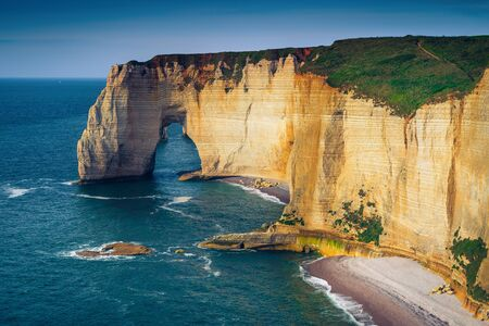 Stunning Atlantic coastline scenery. Amazing beaches with beautiful seashore and high cliffs, Etretat, Normandy, France, Europe