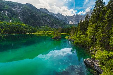 Amazing scenery and popular hiking place. Majestic superior Fusine lake and Mangart peak in background, Julian Alps, Tarvisio, Udine region, Friuli Venezia Giulia, Italy, Europe