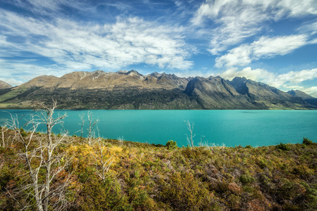 Lake Wakatipu between Queentown and Glenorchy in the South Island of New Zealand. Stock Photo