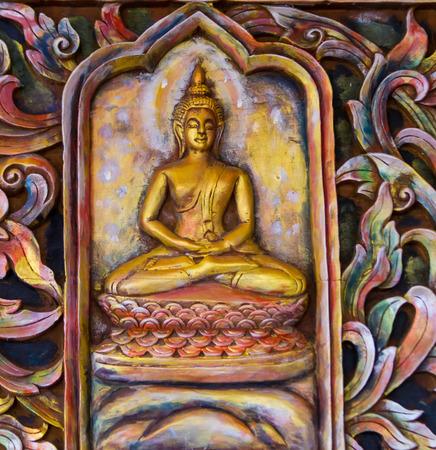 malai: blurred Bhudha statue in Thai temple