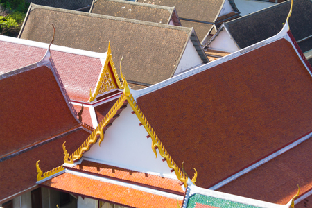 tightness: view over the roofs covered with tiles in the thai temple Stock Photo