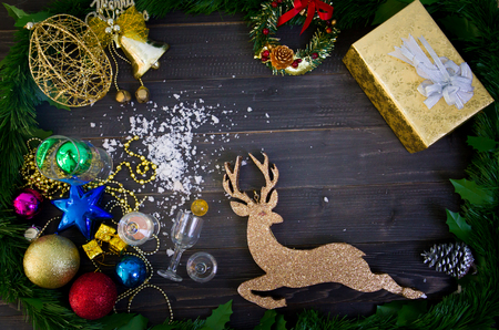 Christmas  frame  decorations on wooden table Top view, Flat lay with copy space. Christmas decorations and objects Christmas fir tree branches