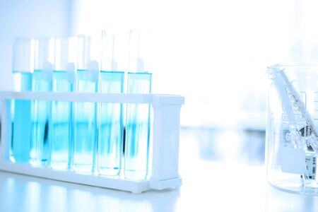 Research Test tube in scientist in laboratory, chemical liquid to test tubes, science and medical research and development concept