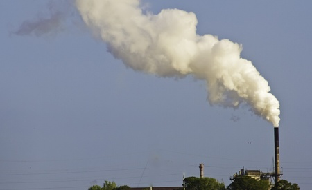 polluting: Smoke stack polluting the air and environment