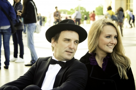 Happy couple dressed in black stylish clothes smiling photo