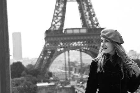 Close up female model in hat Eiffle tower photo