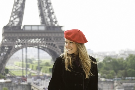 Female model in red hat Eiffel tower background photo