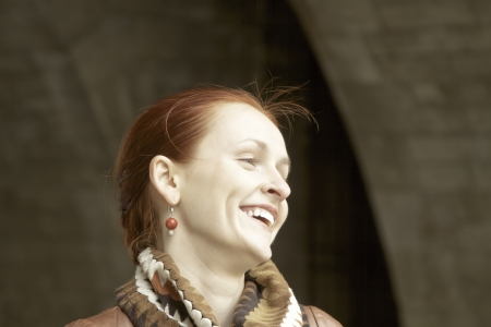 Redhaired model smiling