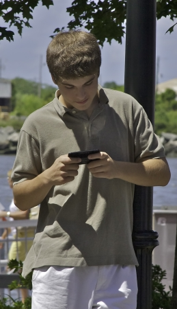 Young male texting photo