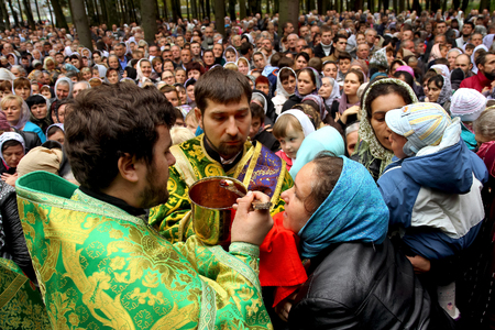 church service: Iza-Karputlash, Ukraine - October 21. 2014: Priests conduct the communion rite during the church service on the occasion of the second Maramarosh-Sigot trial in the Ortodox in St. Nicholas Monastery.