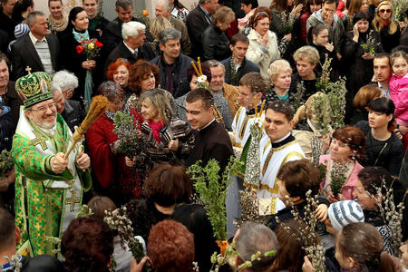 congregation: Uzhgorod, Ukraine - April 13. 2014: Greek Catholic parish congregation celebrate Palm Sunday, one week befor Easter.