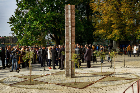 platinum metal: Uzhgorod, Ukraine - 2016 October 9: Participants in the opening ceremony of the monument to local victims of the Holocaust gather on the square near the former synagogue. A monument to local victims of the Holocaust in Uzhgorod made of platinum metal in t Editorial