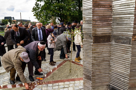 Uzhgorod, Ukraine - October 9, 2016: Participants in the opening ceremony of the monument to local victims of the Holocaust ignited candles on the square near the former synagogue.