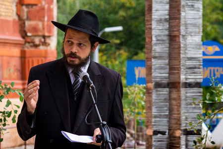 jewish town: Uzhgorod, Ukraine - October 9, 2016: Rabbi prays during the opening ceremony of the monument to local victims of the Holocaust on the square near the former synagogue. Editorial